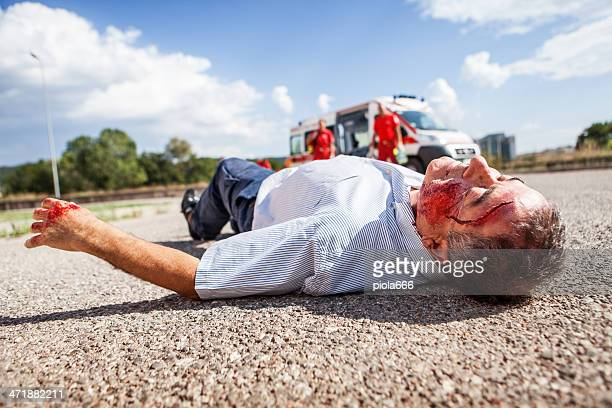 medical emergency team arrives at street accident - bloody car accidents stock pictures, royalty-free photos & images