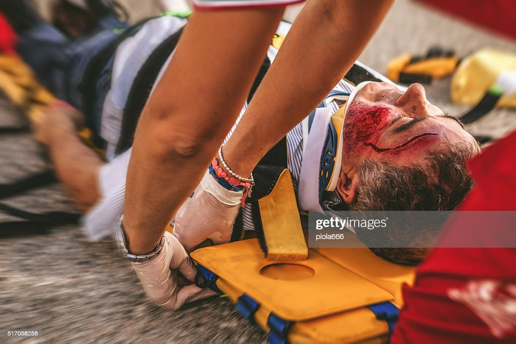 Medical emergency team arrives at street accident : Stock Photo
