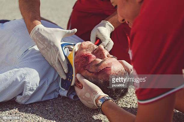 medical emergency team first aid at accident - bloody car accidents stock pictures, royalty-free photos & images