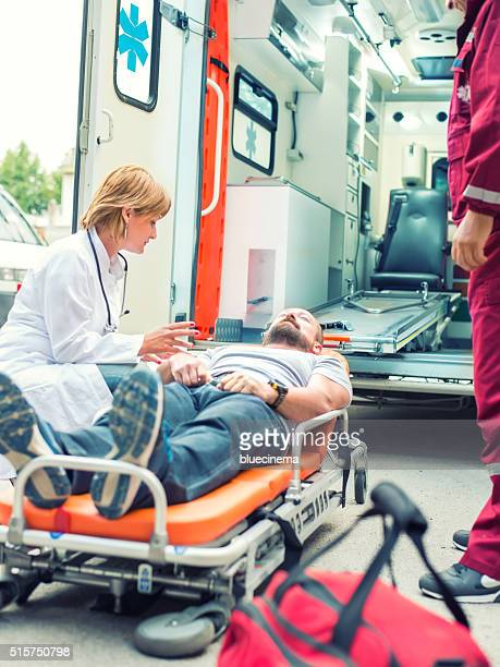 Medical emergency team helping injured man