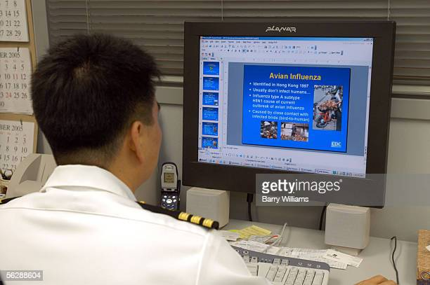 Medical Epidemilolgist Dr David Kim prepares an upcomming training presentation concerning Avian Flu and regulations for reporting sick international...
