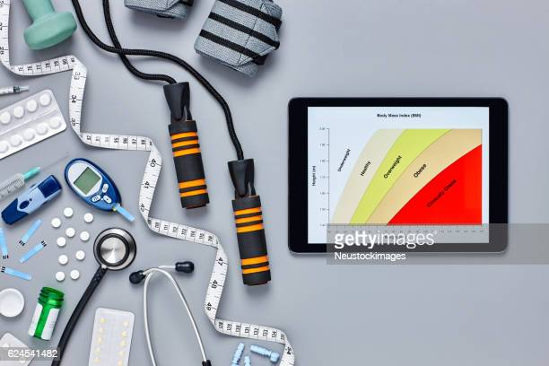 Medical equipment by digital tablet displaying body mass index