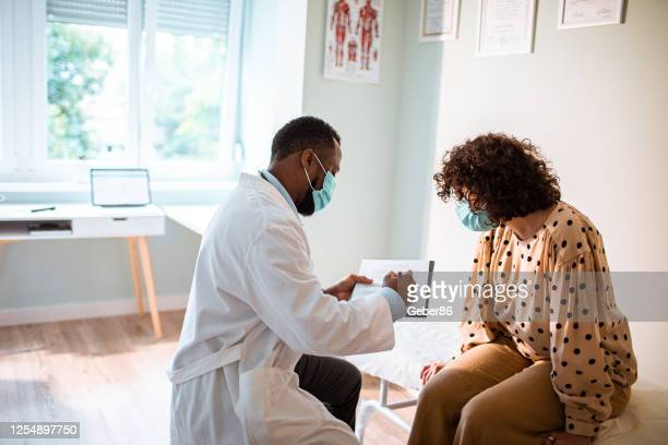 medical exam - protective face mask stock pictures, royalty-free photos & images