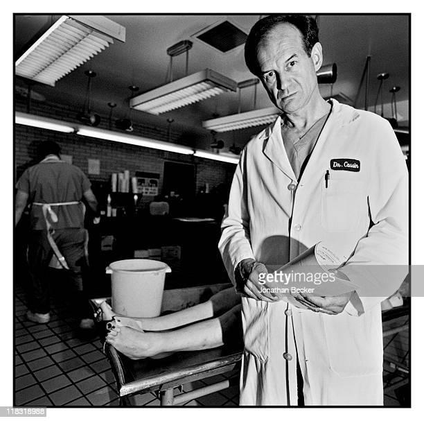 Medical examiner of the Dr Jack Kevorkian case Bader J Cassin MD is photographed for Vanity Fair Magazine on April 1224 1994 in Detroit Michigan...
