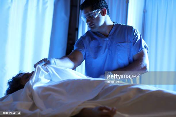 medical examiner with corpse in morgue. - autopsy stock pictures, royalty-free photos & images