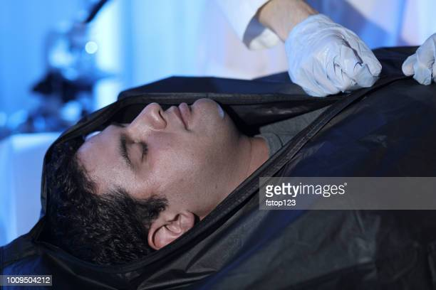medical examiner with corpse in morgue. - drug overdose stock photos and pictures
