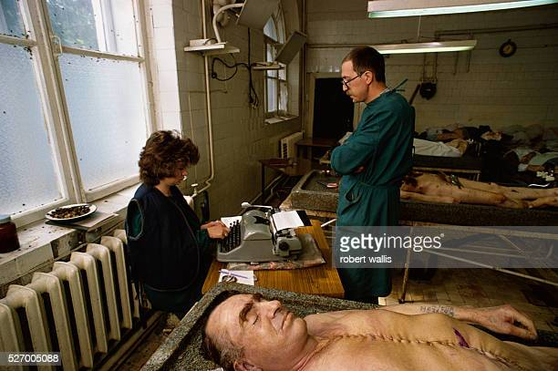 Medical examiners working in police morgue