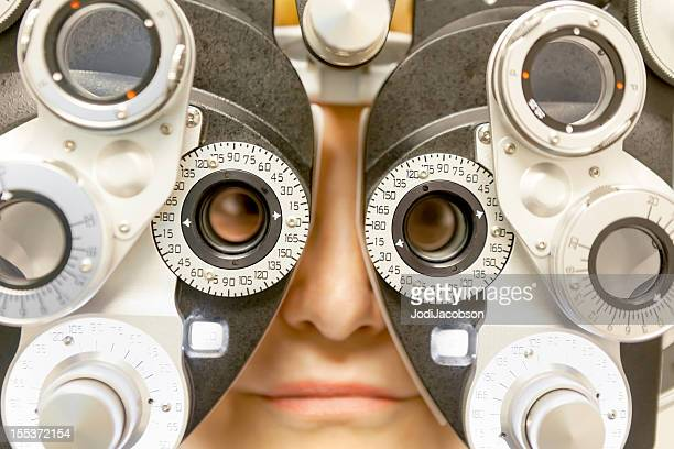 medical: eye exam - lens eye stock photos and pictures
