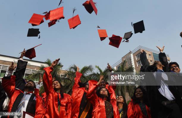 Medical graduates and postgraduates throw their hats in celebration after the 46th Annual Convocation of All India Institute of Medical Sciences at...