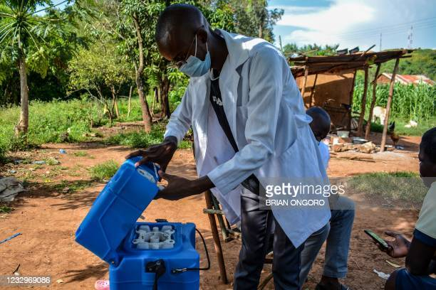 Medical health worker prepares the injection of the Oxford/AstraZeneca Covid-19 vaccine as they visit door-to-door to deliver the vaccines to people...