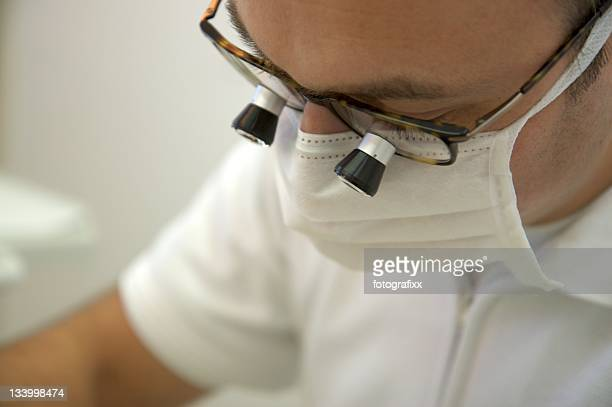 A medical healthcare person uses special glasses to inspect