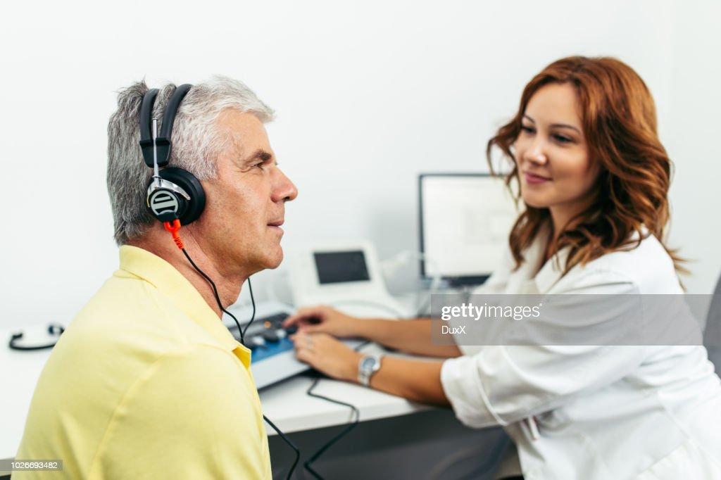 Medical hearing examination : Stock Photo
