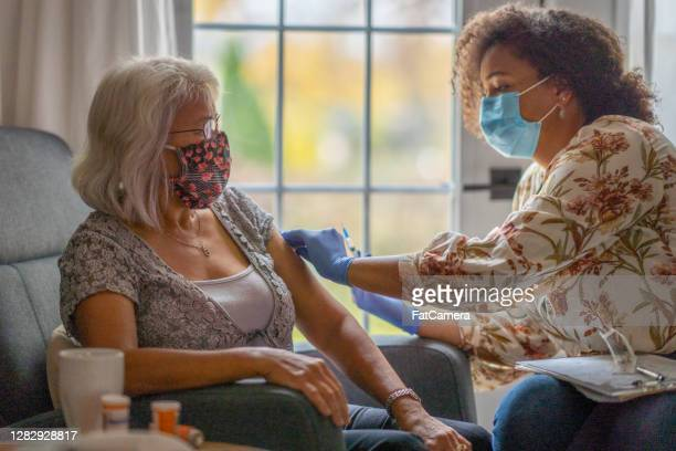 medical home visit - fatcamera stock pictures, royalty-free photos & images