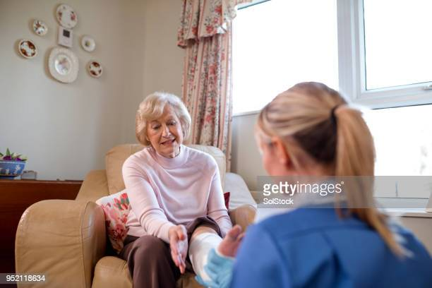 medical home visit - old lady feet stock pictures, royalty-free photos & images