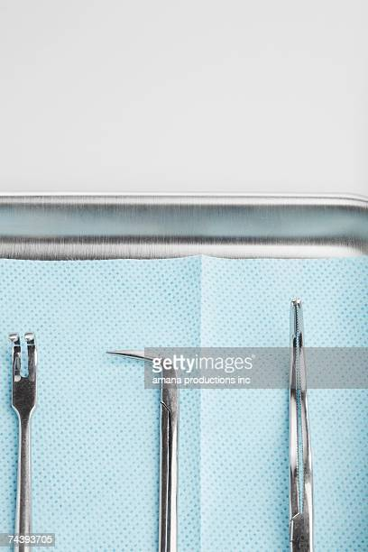Medical instruments on tray (close-up)