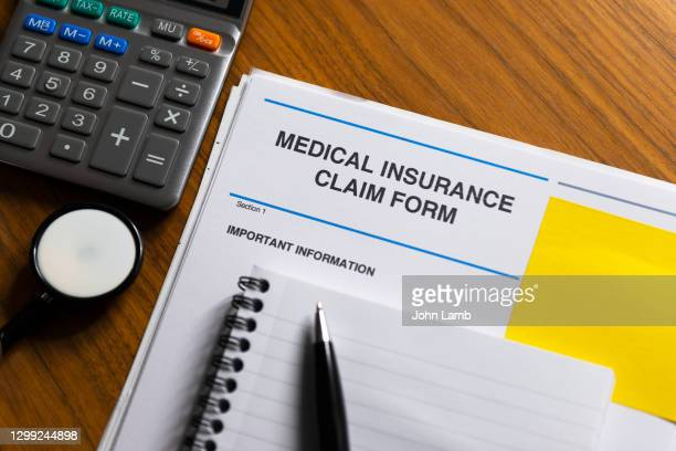 medical insurance claim form close-up. - workers compensation stock pictures, royalty-free photos & images
