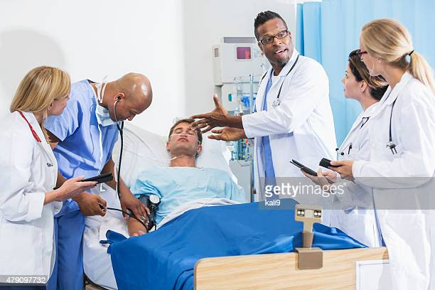 Medical interns at hospital with patient