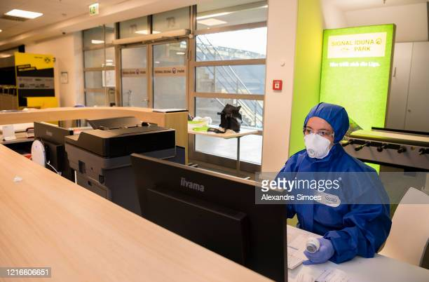 Medical laboratory scientist, Hassana Aazour, wearing protective suits, masks, gloves and goggles looks at a screen in the coronavirus care facility...