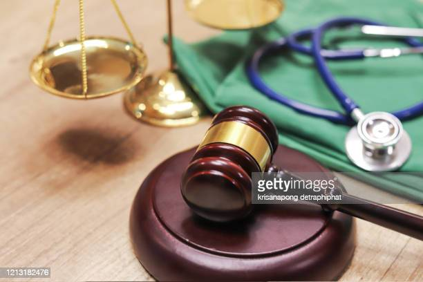 medical law concept,gavel and stethoscope in background. medical laws and legal concept. - lawsuit stock pictures, royalty-free photos & images