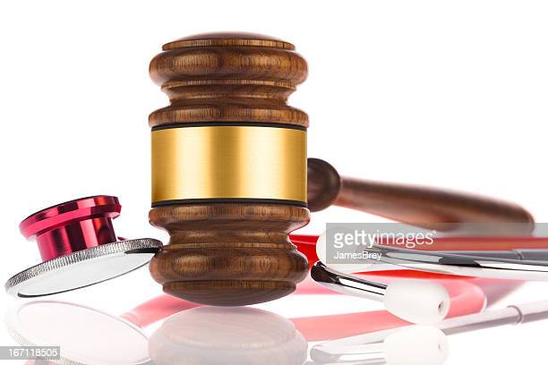 medical malpractice; stethoscope and gavel - medical malpractice stock photos and pictures