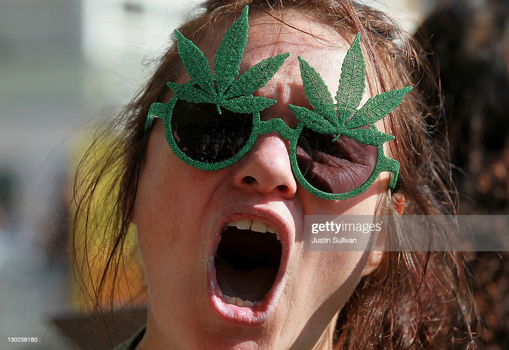 A medical marijuana advocate who goes by the name 'The Holy Hemptress' shouts as she demonstrates outside of the W Hotel where U.S. President Barack Obama is holding a fundraiser on October 25, 2011 in San Francisco, California. Hundreds of protestors from a wide variety of activist groups staged protests outside of the W Hotel where President Obama was holding a $7,500 per person fundraiser.