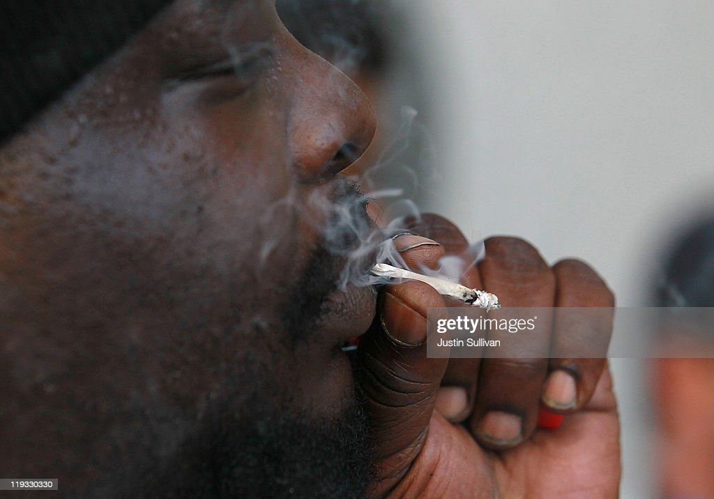Medical marijuana patient Kirk Anderson smokes marijuana during a protest outside of the State of California building on July 18, 2011 in San Francisco, California. Medical marijuana patients and advocates held a demonstration outside of the State of California buildings in San Francisco and Los Angeles to express their concerns over a recent Drug Enforcement Agency memo that suggests that the DEA will reverse U.S. president Barack Obama's 2009 policy to not bring federal drug law prosecutions against individuals in compliance with state medical marijuana laws. Photo by Justin Sullivan/Getty Images)