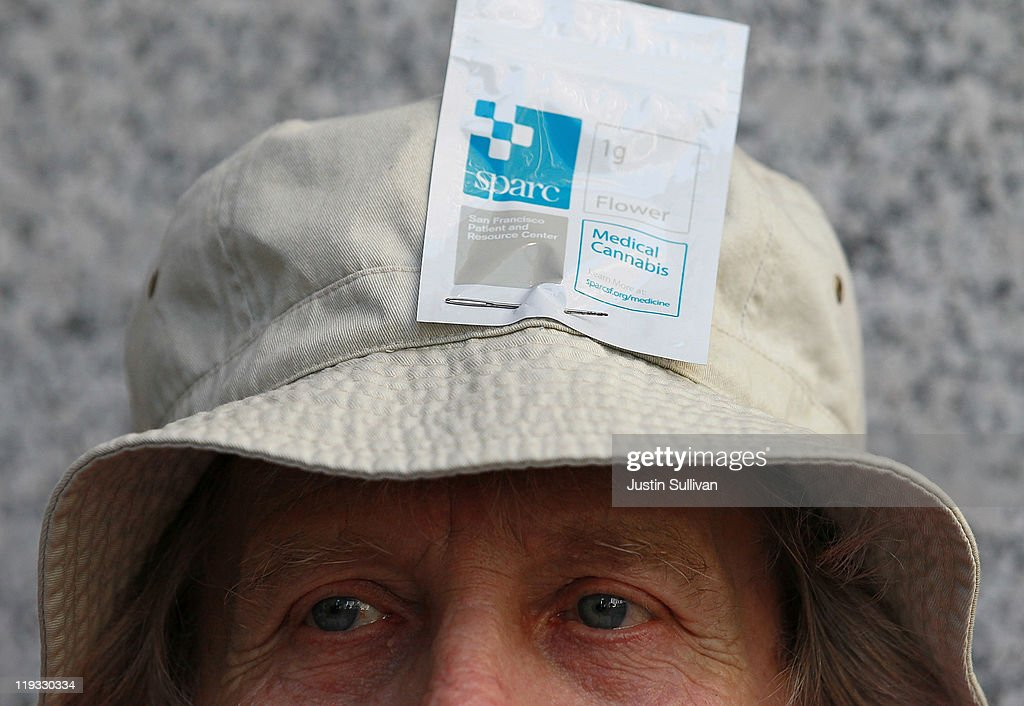 A medical marijuana patient wears a bag of medical marijuana on his hat during a protest outside of the State of California building on July 18, 2011 in San Francisco, California. Medical marijuana patients and advocates held a demonstration outside of the State of California buildings in San Francisco and Los Angeles to express their concerns over a recent Drug Enforcement Agency memo that suggests that the DEA will reverse U.S. president Barack Obama's 2009 policy to not bring federal drug law prosecutions against individuals in compliance with state medical marijuana laws. Photo by Justin Sullivan/Getty Images)