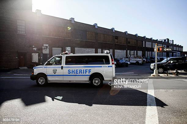 "Medical marijuana program starts in New York"" A sheriff department vehicle passes the Bloomfield Industries Inc building in Long Island City, New..."
