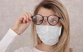 Medical mask and Glasses fogging. Avoid face touching, Coronavirus prevention, Protection.