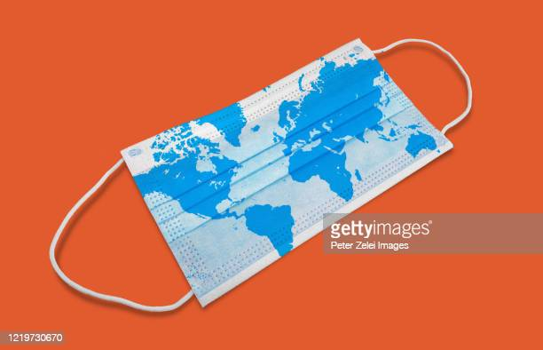 medical mask with world map - world map stock pictures, royalty-free photos & images