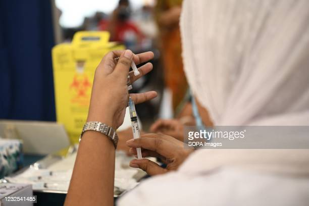 Medical nurse preparing a syringe and an ampule with the 2nd dose of Covishield covid-19 vaccine during the vaccination drive at Bangabandhu Sheikh...