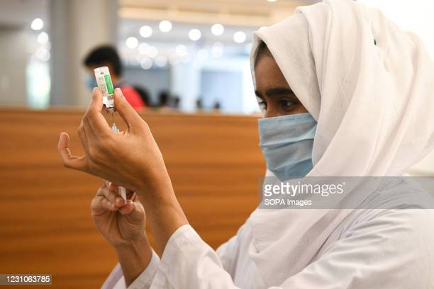 Medical nurse preparing a syringe and an ampule with the dose of Covishield covid-19 vaccine during the vaccination drive at Bangabandhu Sheikh Mujib...