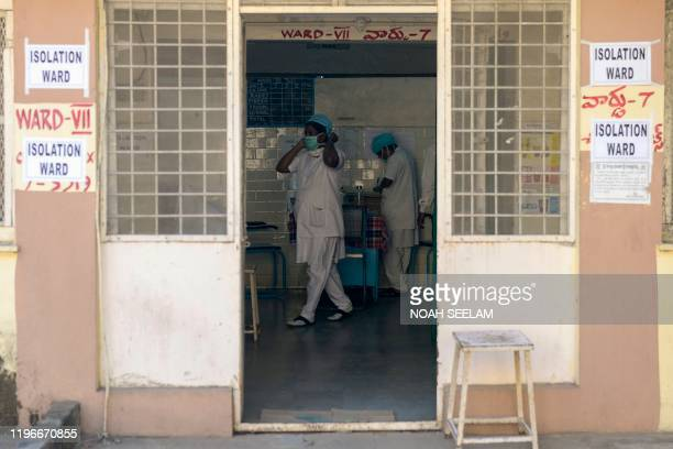 Medical nurses are seen inside an isolation ward as patients coming from Hong Kong requested medical checks as a preventative measure following a...