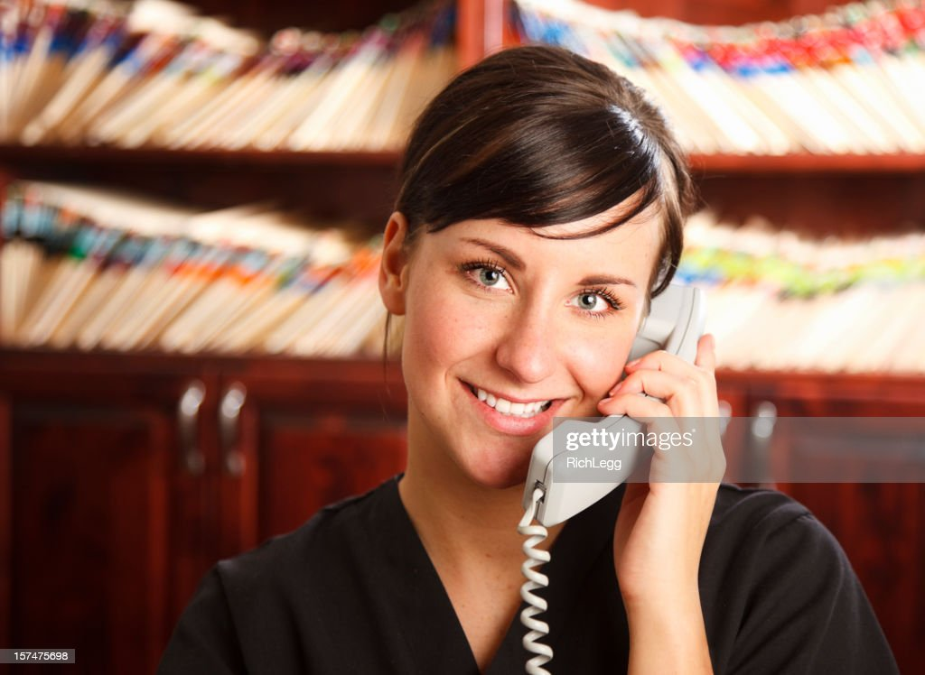 medical office receptionist stock photo getty images