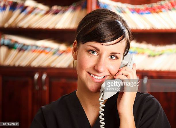 medical office receptionist - medical receptionist uniforms stock photos and pictures