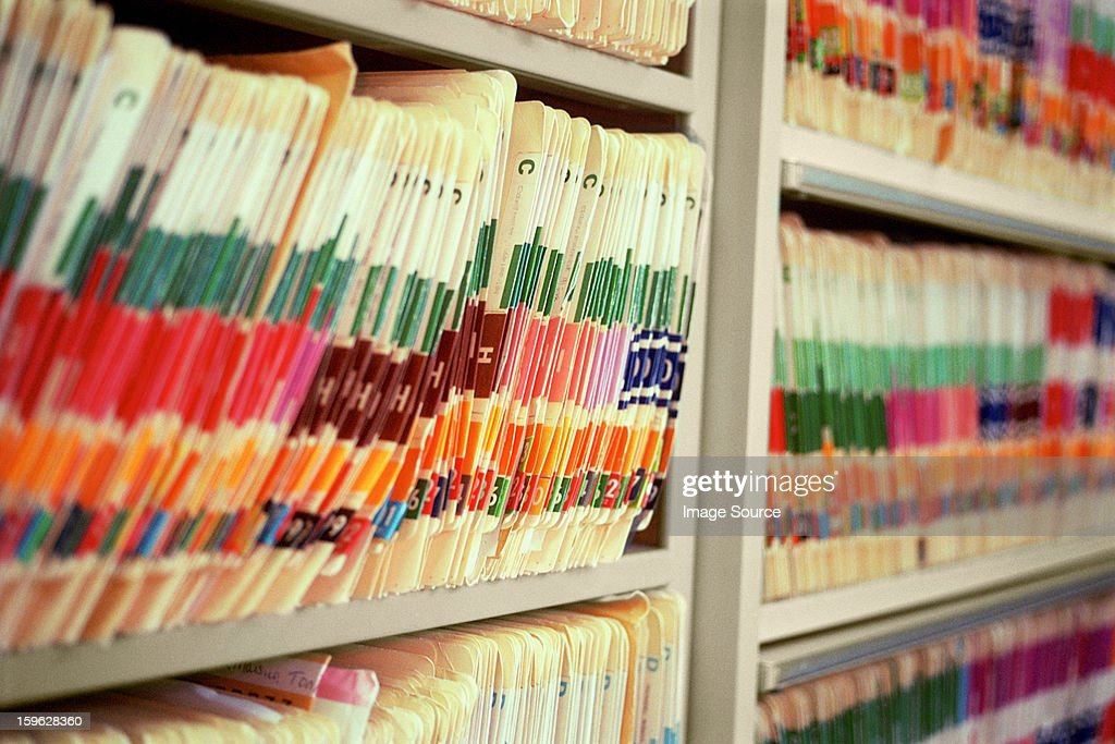 Medical office with shelves of files : Stock Photo
