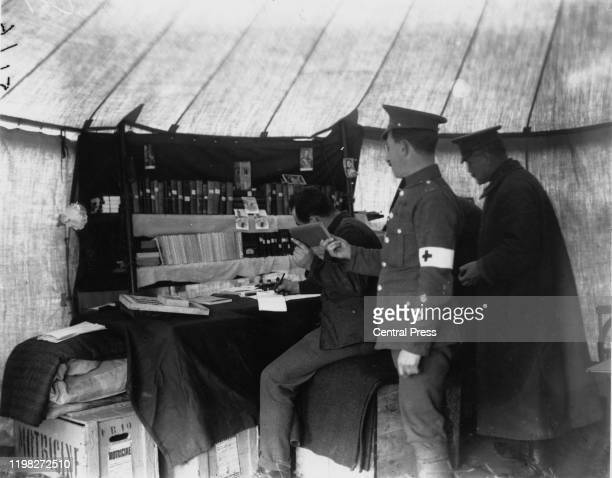A medical officer borrowing a book from a field library at a British camp near Rouen France during World War I 1914