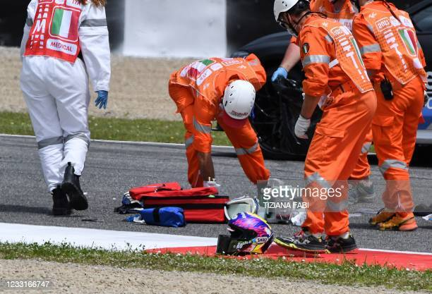 Medical officers clear the track as they evacuate Swiss Moto3 rider Jason Dupasquier in an helicopter after a crash during a qualifying session ahead...