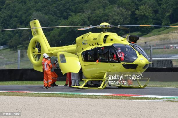 Medical officers evacuate Swiss Moto3 rider Jason Dupasquier in an helicopter after a crash during a qualifying session ahead the Italian Moto GP...