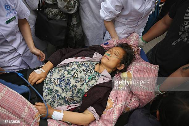 Medical officers treat a patient at the hospital on April 21 2013 in Lushan of Ya An China A magnitude 7 earthquake hit China's Sichuan province on...