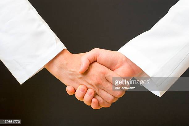 medical people handshake - long sleeved stock pictures, royalty-free photos & images
