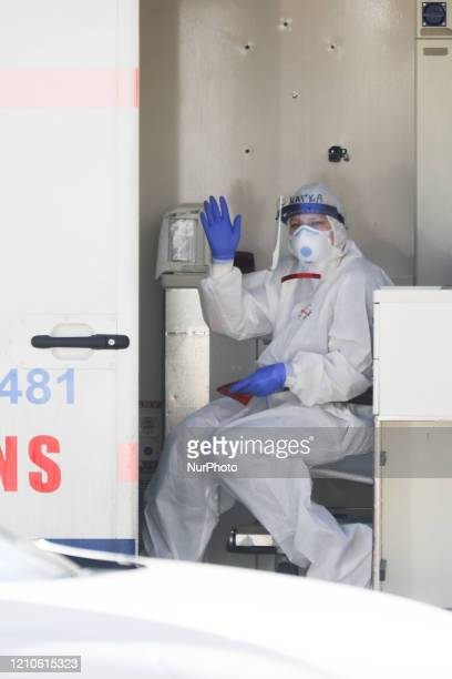 Medical personel wearing protective uniform is seen in an ambulance outside infectious disease ward at University Hospital in Krakow Poland on April...