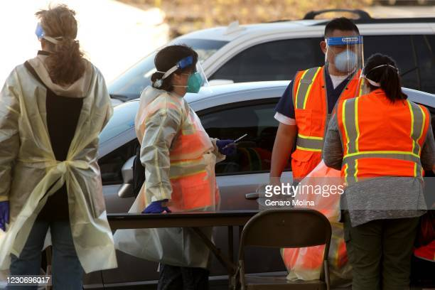 Medical personnel and workers tend to the large scale COVID-19 vaccine site on the first day it opened at California State University Northridge in...
