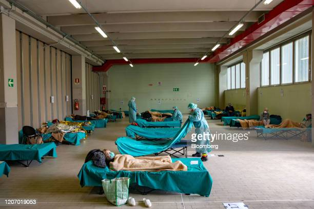 Medical personnel care for patients in an emergency temporary room set up to ease pressure on the healthcare system at a hospital in Brescia Italy on...