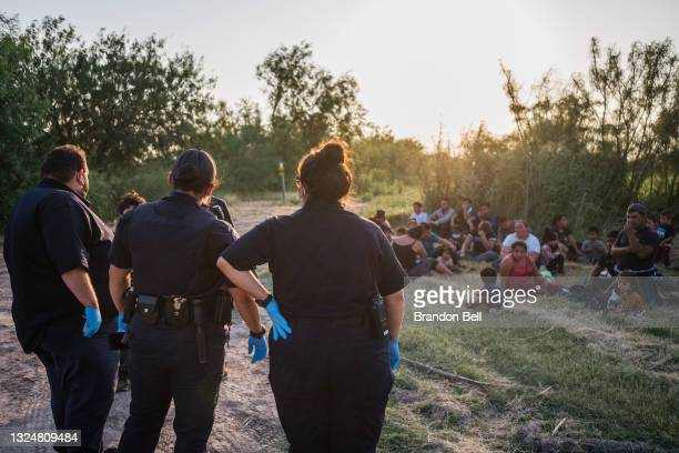 Medical personnel check in with immigrants after they crossed the Rio Grande into the U.S. On June 21, 2021 in La Joya, Texas. A surge of mostly...