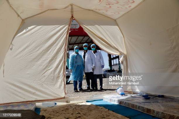 Medical personnel check people's temperature on the street as a precautionary measure against the spread of coronavirus COVID-19 on April 05, 2020 on...