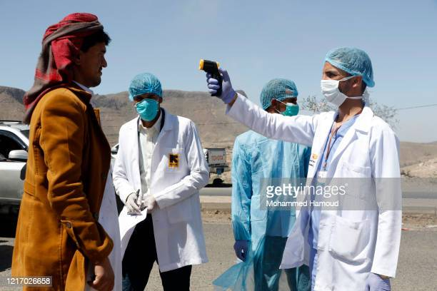 Medical personnel check people's temperature on the street as a precautionary measure against the spread of coronavirus COVID19 on April 05 2020 on...