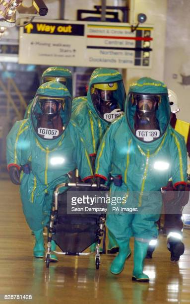 Medical personnel dressed in thick green rubber suits attend a simulated terrorist attack at Bank underground station in the centre of London...