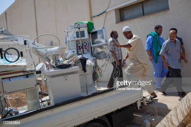 Medical personnel from a local hospital load medical equipment from at a medical clinic at Baba al Azizia, Moammar Gaddafi's main military compound...