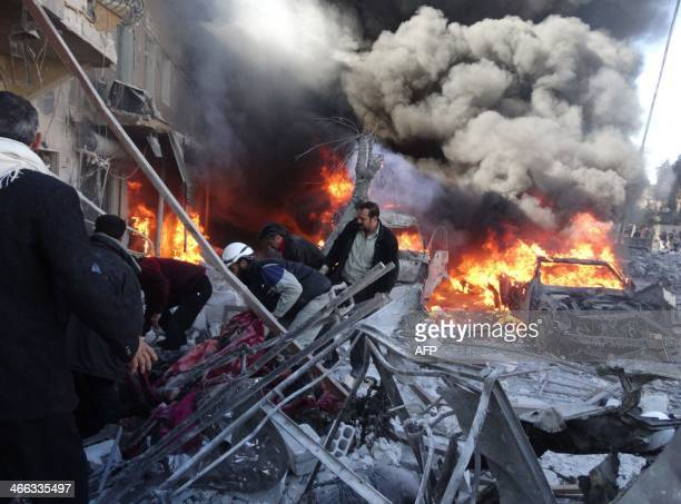Medical personnel look for survivors following a reported airstrike on the Tariq alBab district of the northern Syrian city of Aleppo on February 1...